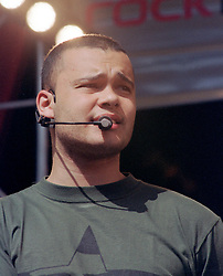 """Sean ( full name Sean Keiran Conlon) of the Boy band Five performing on stage at """" Feel The Noise"""". A Local Radio stations (Rock FM)  charity pop event which was held at Blackburn Rovers Football Ground Saturday 2nd June 2001."""
