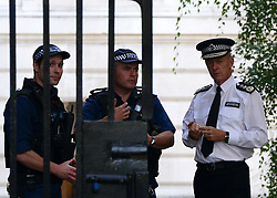 © Licensed to London News Pictures. 06/09/2012. Westminster, UK  Chief of The Metropolitan Police Bernard Hogan Howe talks to police officers on Downing Street today 06th September 2012 Photo credit : Stephen Simpson/LNP