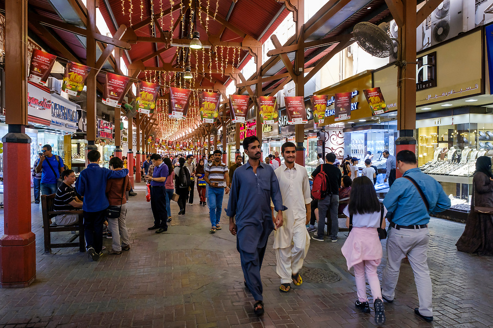 UNITED ARAB EMIRATES, DUBAI - CIRCA JANUARY 2017: People walking and shopping for jewelry at the famous Gold Souq in Dubai