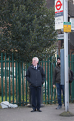 © Licensed to London News Pictures. 16/03/2016. London, UK.  Labour Shadow Chancellor John McDonnell waits for a bus as he heads for Parliament on Budget day. Later Chancellor George Osborne will deliver his eighth budget to MPs.  Photo credit: Peter Macdiarmid/LNP