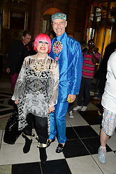 ZANDRA RHODES and ANDREW LOGAN at the opening of Club To Catwalk: London Fashion In The 1980's an exhibition at The V&A Museum, London on 8th July 2013.