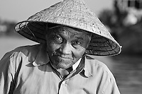 The Hoi An boatman in black and white.