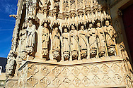 Tympanum of central west portal: an array of saints.  Gothic Cathedral of Notre-Dame, Amiens, France . The Cathedral Basilica of Our Lady of Amiens or simply Amiens Cathedral, is a Roman Catholic  cathedral the seat of the Bishop of Amiens. It is situated on a slight ridge overlooking the River Somme in Amiens. Amiens Cathedral, was built almost entirely between 1220 and c.1270, a remarkably short period of time for a Gothic cathedral, giving it an unusual unity of style. Amiens is a classic example of the High Gothic style of Gothic architecture. It also has some features of the later Rayonnant style in the enlarged high windows of the choir, added in the mid-1250s. Amiens Cathedra has been listed as a UNESCO World Heritage Site since 1981. Photos can be downloaded as Royalty Free photos or bought as photo art prints. <br /> <br /> Visit our MEDIEVAL PHOTO COLLECTIONS for more   photos  to download or buy as prints https://funkystock.photoshelter.com/gallery-collection/Medieval-Middle-Ages-Historic-Places-Arcaeological-Sites-Pictures-Images-of/C0000B5ZA54_WD0s