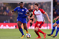 Jay Rodriguez of West Bromwich Albion battles with Wes Morgan of Leicester city (l) .Premier league match, Leicester City v West Bromwich Albion at the King Power Stadium in Leicester, Leicestershire on Monday 16th October 2017.<br /> pic by Bradley Collyer, Andrew Orchard sports photography.