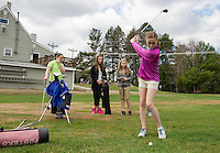 Hannah Frazier drives off the 9th tee at Bolduc Park Friday morning with fellow Fosters Golf campers.   (Karen Bobotas/for the Laconia Daily Sun)