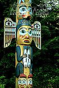 Alaska. Southeast, Ketchikan,  Saxman Native Village Totem Pole Park.  Totem poles, silent storytellers of Tlingit myths and legends. Indian carved totem poles.