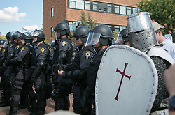 September 29, 2018 - Kent, Ohio, United States - A man dressed as a Crusades knight stands with police during an open carry rally at Kent State University in Kent, Ohio on September 29, 2018. (Credit Image: © Emily Molli/NurPhoto/ZUMA Press)