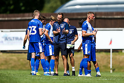 Bristol Rovers manager Ben Garner speaks to Tom Mehew of Bristol Rovers - Rogan/JMP - 08/08/2020 - FOOTBALL - The Creek - Bristol, England - Bristol Manor Farm v Bristol Rovers - Pre-season Friendly
