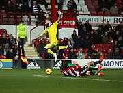 Brentford defender Harlee Dean and Brentford goalkeeper David Button stopping Leeds United striker Mirco Antenucci during the Sky Bet Championship match between Brentford and Leeds United at Griffin Park, London, England on 26 January 2016. Photo by Matthew Redman.