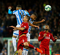 Huddersfield Town's Karlan Ahearne-Grant and Steve Mounie battles with Liverpool's Dejan Lovren<br /> <br /> Photographer Alex Dodd/CameraSport<br /> <br /> The Premier League - Liverpool v Huddersfield Town - Friday 26th April 2019 - Anfield - Liverpool<br /> <br /> World Copyright © 2019 CameraSport. All rights reserved. 43 Linden Ave. Countesthorpe. Leicester. England. LE8 5PG - Tel: +44 (0) 116 277 4147 - admin@camerasport.com - www.camerasport.com