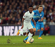 England's Raheem Sterling runs away as the pitch cuts up behind him<br /> <br /> - International European Qualifier - England vs Slovenia- Wembley Stadium - London - England - 15th November 2014  - Picture David Klein/Sportimage