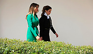 First Lady Melania Trump and Queen Rania of Jordan walk from the Rose Garden to the White House.<br />Photo by Dennis Brack