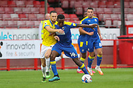 Brighton and Hove Albion midfielder Andrew Crofts (48) battles with AFC Wimbledon attacker Zach Robinson (14) during the EFL Trophy Southern Group G match between AFC Wimbledon and Brighton and Hove Albion U21 at The People's Pension Stadium, Crawley, England on 22 September 2020.