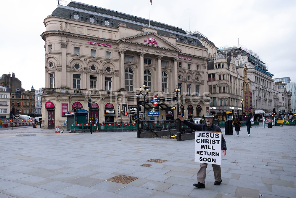 Street preacher extoling the ways of the Lord Jesus Christ at Piccadilly Circus in a scene of empty desolation as the national coronavirus lockdown three continues on 29th January 2021 in London, United Kingdom. Following the surge in cases over the Winter including a new UK variant of Covid-19, this nationwide lockdown advises all citizens to follow the message to stay at home, protect the NHS and save lives.