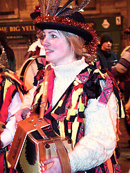 Elitabeth  Stocker a member of the Wath Morris Men in  Wath Town Square on Sunday Night as part of the Wath Fire Festival<br /><br />Sunday23-12-2001