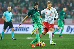 Wroclaw, Poland - 2016 November 14: (L) Miha Mevlja of Slovenia fights for the ball with (R) Lukasz Teodorczyk of Poland during Poland v Slovenia - International Friendly Soccer Match at Municipal Stadium on November 14, 2016 in Wroclaw, Poland.<br /> <br /> Adam Nurkiewicz declares that he has no rights to the image of people at the photographs of his authorship.<br /> <br /> Picture also available in RAW (NEF) or TIFF format on special request.<br /> <br /> Any editorial, commercial or promotional use requires written permission from the author of image.<br /> <br /> Mandatory credit:<br /> Photo by © Adam Nurkiewicz / Mediasport