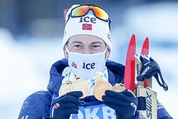 Sturla Holm Laegreid of Norway celebrates with medals after the IBU World Championships Biathlon 15 km Mass start Men competition on February 21, 2021 in Pokljuka, Slovenia. Photo by Vid Ponikvar / Sportida