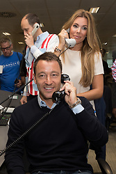 September 11, 2018 - London, London, UK - London, UK.  John Terry with his wife at the 14th Annual BGC Charity Day held on the trading floor of BGC Partners in Canary Wharf, to raise money for charitable causes in commemoration of BGC's 658 colleagues and the 61 Eurobrokers employees lost on 9/11. (Credit Image: © Vickie Flores/London News Pictures via ZUMA Wire)
