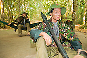 10 MARCH 2006 - CU CHI TUNNELS, VIETNAM: Mannequins used in a display of the living conditions of communist forces at the Cu Chi Tunnel Museum in Cu Chi, Vietnam. The tunnels are famous because the communist forces who lived in the area and dug the tunnels were able to withstand near constant American bombings and attacks during the Vietnam War (which is called the American War in Vietnam). The tunnels are also an important tourist attraction, drawing thousands of visitors a month. The tunnels are only about 30 miles from downtown Ho Chi Minh City (formerly Saigon) and fall within the city limits of Ho Chi Minh City.   Photo by Jack Kurtz