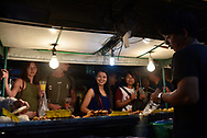 Locals and tourists buy food from vendors at the Thong Sala night market on the Thai island of Ko Phangan. (June 2017)