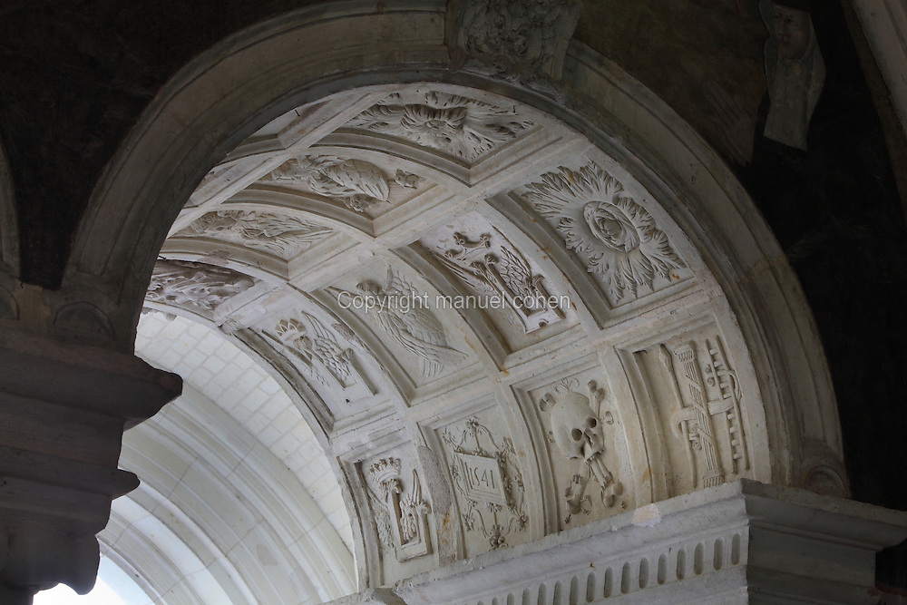Arch separating the Salle Capitulaire or Chapter House from the cloister, with vaults covered in stone reliefs, including winged crowned Ls, symbol of Louise de Bourbon, Abbess of Fontevraud 1534-75, and other members of the Bourbon-Vendome family, 16th century, at Fontevraud Abbey, Fontevraud-l'Abbaye, Loire Valley, Maine-et-Loire, France. The abbey was founded in 1100 by Robert of Arbrissel, who created the Order of Fontevraud. It was a double monastery for monks and nuns, run by an abbess. The abbey is listed as a historic monument and a UNESCO World Heritage Site. Picture by Manuel Cohen