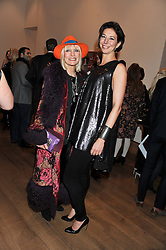 Left to right, VIRGINIA BATES and CHRISTINA BLAHNIK at the launch of the Krug Happiness Exhibition at The Royal Academy, 6 Burlington Gardens, London on 12th December 2011.
