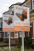 Estate agent signs for apartment flats for sale, Spring Road, Ipswich, Suffolk, England, UK