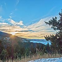 The sun sets behind Mount Ellis in Montana's Gallatin Range of the Rocky Mountains.