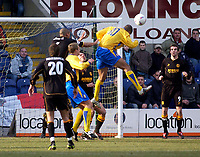 Photo. Glyn Thomas.<br /> Mansfield Town v Hull City.<br /> Nationwide League Division 3.<br /> Field Mill, Mansfield. 06/03/2004.<br /> Mansfield Town's Laurent D'Jeffo (second from R) scores for his side with a header from a corner.