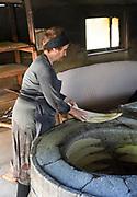 Woman Backing Traditional Georgian Bread, Tiblisi, Georgia