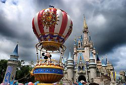 Mickey and Minnie appear under stormy skies during the afternoon parade, shortly before the Magic Kingdom at Walt Disney World in Lake Buena Vista, Fla., closed early due to weather spawned by Hurricane Dorian, Tuesday, September 3, 2019. Photo by Joe Burbank/Orlando Sentinel/TNS/ABACAPRESS.COM