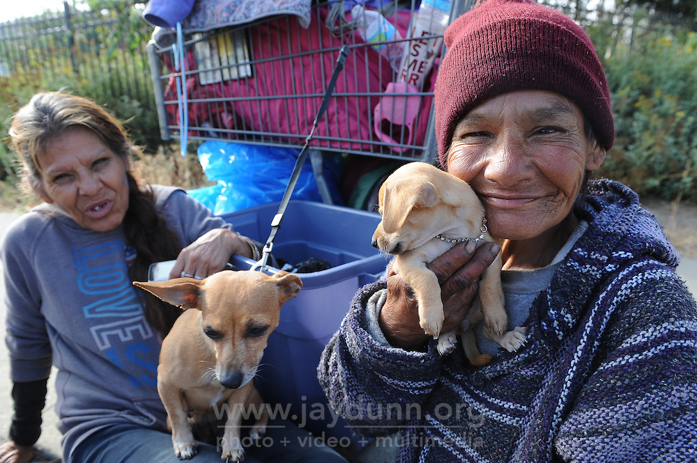 Soledad Street residents Shorty Soto, right, and her sister Diana were displaced during Thursday morning's sweep of Chinatown by the city of Salinas. Diana is holding Ashley, mother of little Teacup.