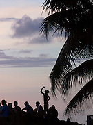 Local man takes a picture of the forming monsoon clouds on his mobile phone, Papanasham Beach (Beach of Redemption) at sunset, Varkala, Kerala, India