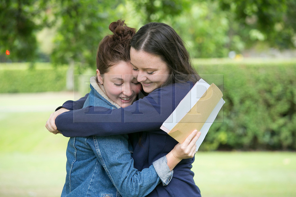 © Licensed to London News Pictures. 13/08/2015. Solihull, West Midlands, UK. A level results day at Solihull School. A record breaking year for the school as it had 88% of students with A Star to B passes. Pictured, Caitlin Moylan, left and Poppy Eales. Photo credit : Dave Warren/LNP