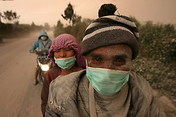 AUGUST 02 - Karo, Indonesia - Villagers wearing masks while volcanic ash spews from Mount Sinabung as seen from Beganding Village at Karo, North Sumatra, Indonesia. Mount Sinabung is one of the most active volcanos in Indonesia. (Credit Image: © Yt Haryono/Xinhua via ZUMA Wire)