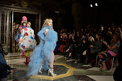 © Licensed to London News Pictures. 16/02/2018. LONDON, UK. Models presents looks by Pam Hogg at Fashion Scout AW18, part of London Fashion Week, taking place at Freemasons Hall in Covent Garden.  Watching from the front row are Lisa Snowdon and Yasmin Le Bon.  Photo credit: Stephen Chung/LNP