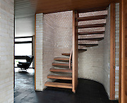Modern 1960s wooden staircase with grey brick wall