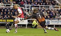Photo. Jed Wee<br />Newcastle United v Arsenal, FA Barclaycard Premiership, St. James' Park, Newcastle. 09/02/2003.<br />Arsenal's Thierry Henry (L) eludes Newcastle goalkeeper Shay Given to score the game's opening goal.