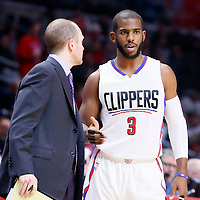 16 December 2015: Los Angeles Clippers guard Chris Paul (3) talks to Los Angeles Clippers Assistant Coach Lawrence Frank during the Los Angeles Clippers 103-90 victory over the Milwaukee Bucks, at the Staples Center, Los Angeles, California, USA.