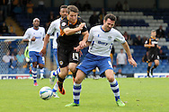 Newport County's Conor Washington (l) is tackled by Bury's Tommy Miller. Skybet Football League two match, Bury v Newport county at Gigg Lane in Bury on Saturday 5th Oct 2013. pic by David Richards, Andrew Orchard sports photography,
