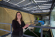 Saskya Huggins  of Low Carbon Hub inside Osney Lock hydro, the first hydro scheme to be built on the river Thames. It also has Solar PV panels on the roof. Low Carbon Hub, Oxford. A community energy hub developing community owned renewable energy projects across Oxfordshire.  ALL publication MUST include the credit © Andrew Aitchison / ASHDEN.