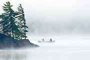Canoeing in mist<br />Algonquin Provincial Park<br />Ontario<br />Canada