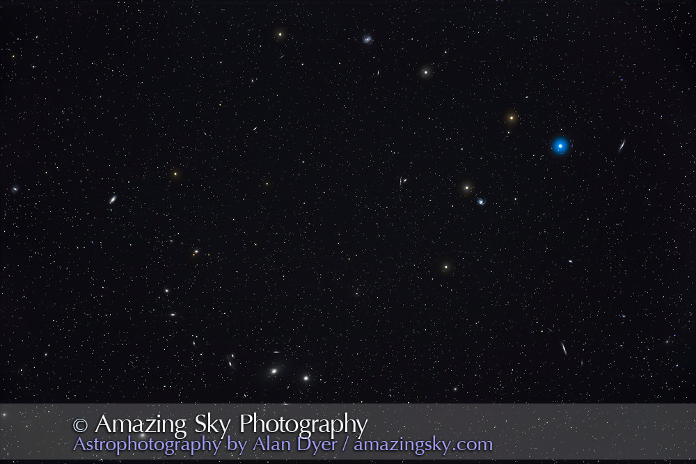 A wide-field image of the Coma-Virgo Galaxy Cluster including the Messier galaxies around the star 6 Comae at top right, down to the galaxies of Markarian's Chain at bottom left, including several other Messiers. The field is about 4 degrees high and 6 degrees wide. <br /> <br /> This is a stack of 5 x 8-minute exposures through the SharpStar 76mm EDPH refractor and with the SharpStar flattener/reducer for f/4.5, and with the Canon EOS Ra at ISO 800. An additional exposure taken through light cloud layered in added the star glows. Clouds prevented more exposures.