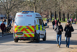 © Licensed to London News Pictures. 22/01/2021. London, UK. Police patrol a busy Hyde Park in London as members of the public enjoy a walk in the sunshine. Today, Prime Minister Boris Johnson will address the nation at a 5pm Downing Street press briefing as the government downplays the idea of a universal £500 covid payment for those who self-isolate. A leaked government document suggested giving £500 to anyone who tested positive for coronavirus as death rates continue to rise in England. Photo credit: Alex Lentati/LNP