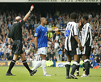 Fotball<br /> England 2004/2005<br /> Foto: SBI/Digitalsport<br /> NORWAY ONLY<br /> <br /> Everton v Newcastle United<br /> FA Barclays Premiership<br /> 07/05/2005.<br /> <br /> Newcastle's Shola Ameobi is sent off for a push on Everton's Tim Cahill