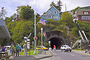 Ketchikan, Alaska. Waterfront area of Ketchikan with native carvings and shopping opportunities intermingling the cultures of Alaska.