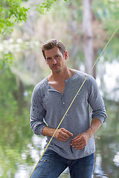 good looking man with a fishing pole