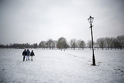 © Licensed to London News Pictures. 01/03/2018. London, UK. People make their way to work on a frozen Clapham Common after more snow fell overnight. The 'Beast from the East' and Storm Emma have brought extreme cold and heavy snow to the UK. Photo credit: Peter Macdiarmid/LNP