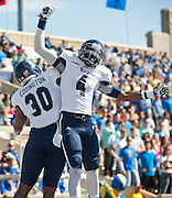Oct 5, 2013; Tulsa, OK, USA; Rice Owls tight end Jeremy Eddington (30) and wide receiver Dennis Parks (4) celebrate a touchdown during a game against the Tulsa Hurricanes at Skelly Field at H.A. Chapman Stadium. Rice defeated Tulsa 30-27 in an overtime. Mandatory Credit: Beth Hall-USA TODAY Sports