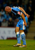 Photo: Richard Lane.<br />Cheltenham Town v Wycombe Wanderers. Coca Cola League 2. Play off Semi Final, 2nd Leg. 18/05/2006. <br />Wycombe's Tommy Mooney struggles with an injury
